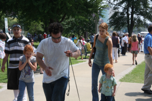 crowds walking along the Mississippi River