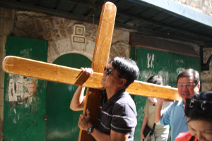 carrying the cross on via dolorosa