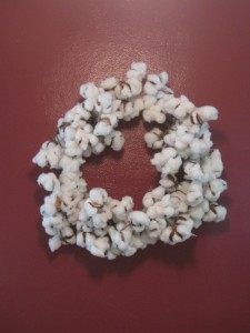 a wreath made of cotton bolls that was a housewarming gift