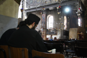 orthodox priests in the Church of the Nativity (May 2011)