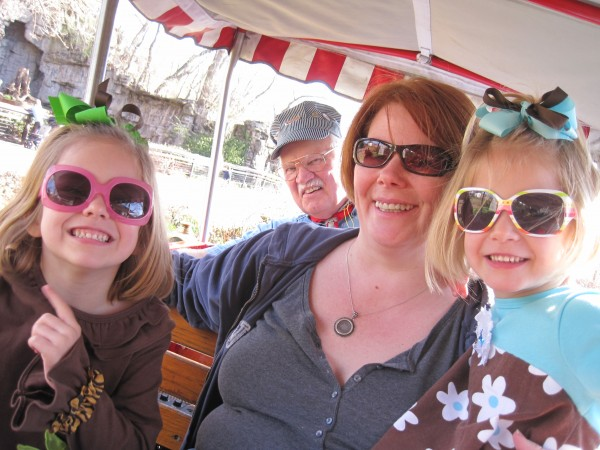 riding on the zoo train -- all aboard!