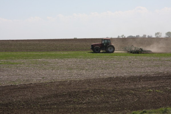 tractor tilling a field