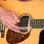 picking guitar