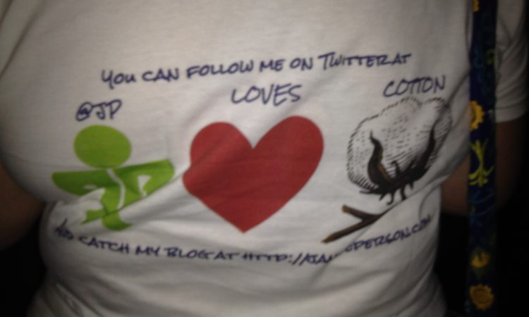 the back of my Twitter shirt JP loves COTTON in symbols