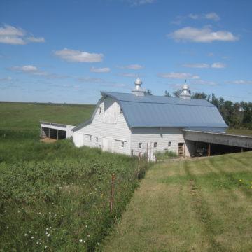 farm land with a barn