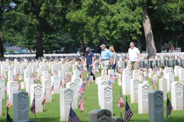family walking through Memphis National Cemetery