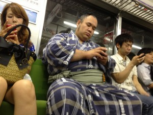sumo wrestler on the subway